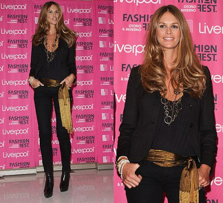Another fall trend is wearing a fringe scarf as a belt as shown on Elle MacPherson.