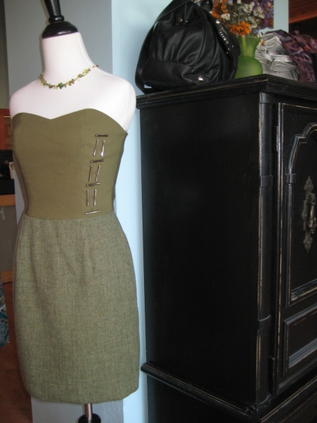 Beautiful olive green Yana K dress with silver metal embellishments.  It also has pockets!  $216.