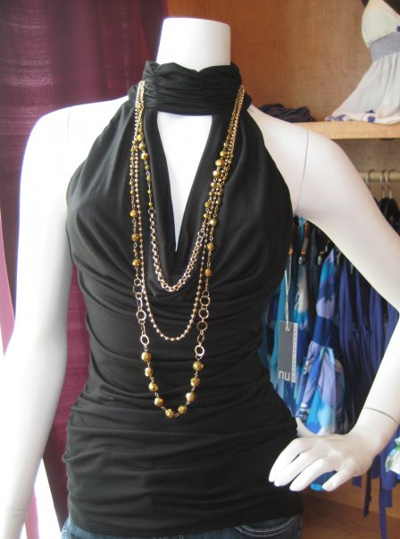 Trend alert:  multistrand necklaces built into tops/tanks.  This example by Nu is $150.