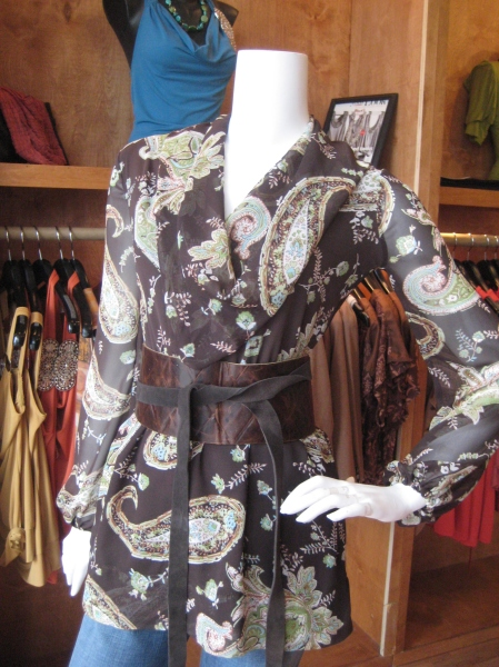 So work-chic!  This patterned chiffon blouse has a conservative cowl neck and matching belt, though for the photo we choose to accessorize it with another leather belt by Adirienne.  Chocolate paisley top, $140.  Belt, $68.