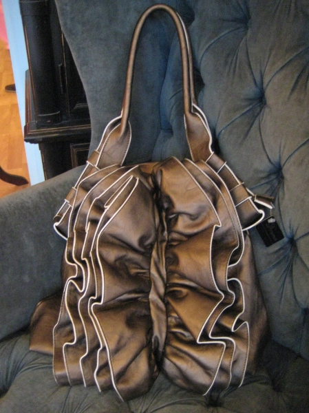 On-trend bronze bag reminds me of Valentino design....LUV! $80.