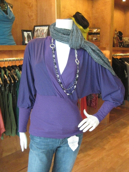 Do you find a Vikings Jersey to be less than flattering to your figure?  Cheer on your team in this sexy top that leaves no doubt to which team you are loyal to.  Bella Matto, $68.  Also available in steel gray.