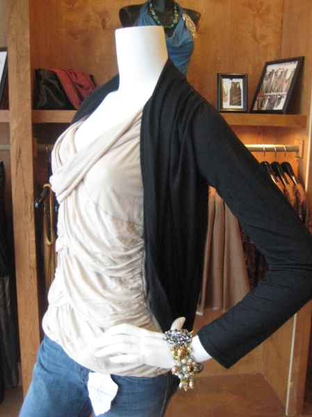 "Very flattering ""oval"" shrug wrap comes in black or magenta.  This photo doesn't do it justice!  Beautiful draping.  $72"