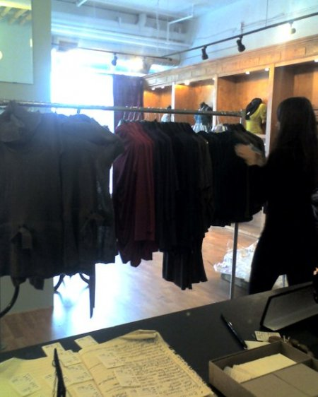 Intern Milana checks in merchandise for the Uptown Boutique Crawl.